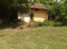 An old house with 1300 sq m of land. Near to forests, lovely location.